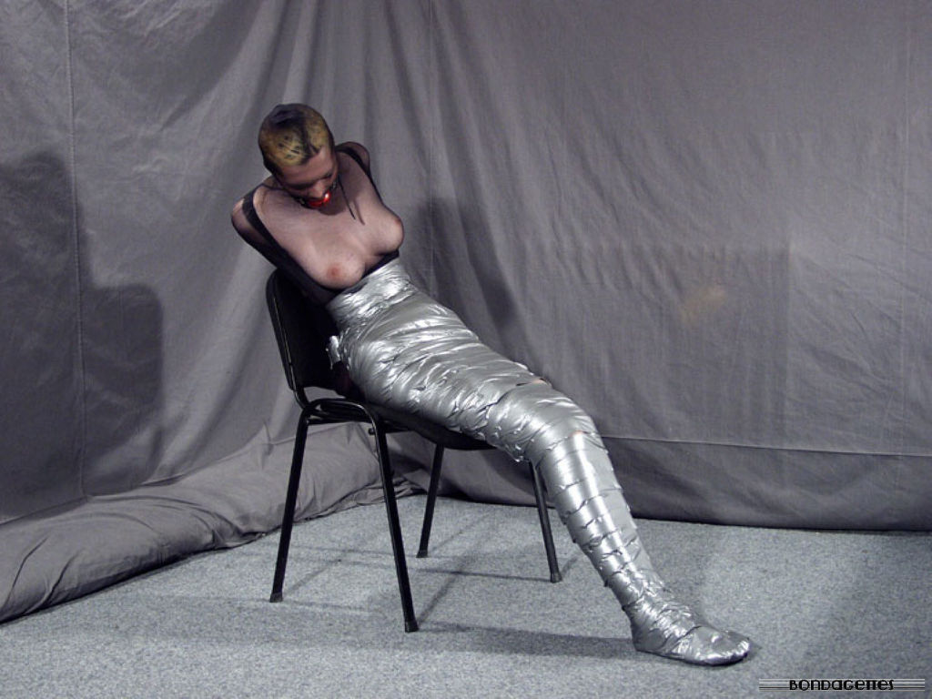 Mistress Monique ties her beautiful blonde slave g