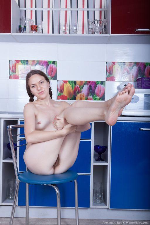 Alexandra Rey strips naked in her kitchen