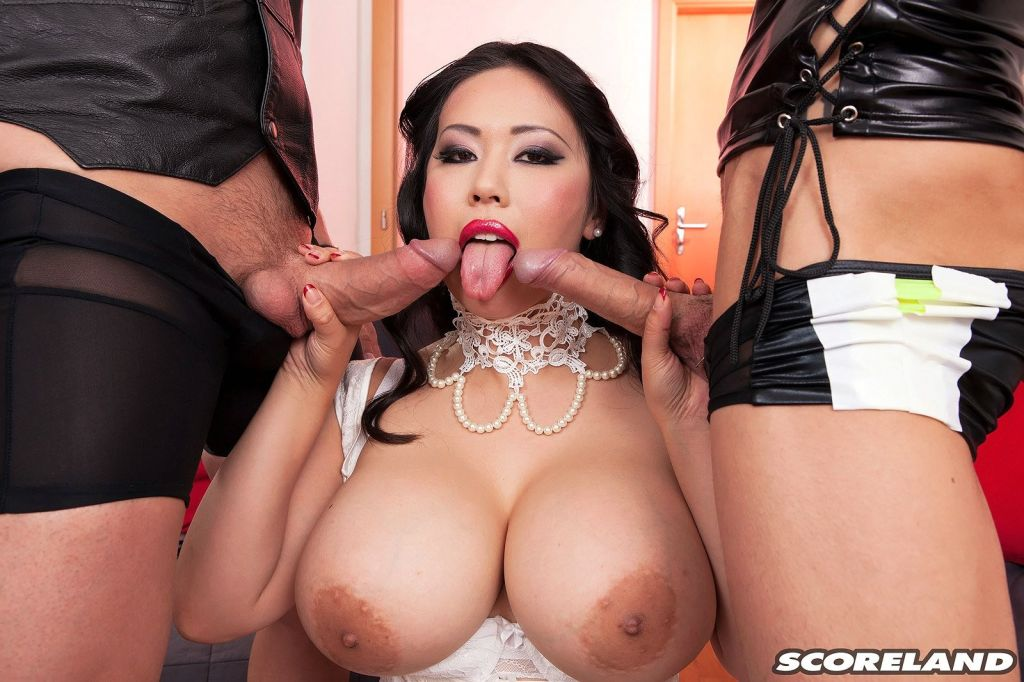 Busty asian mistress Tigerr Benson sucking two coc