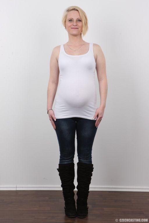 Mature pregnant wife poses