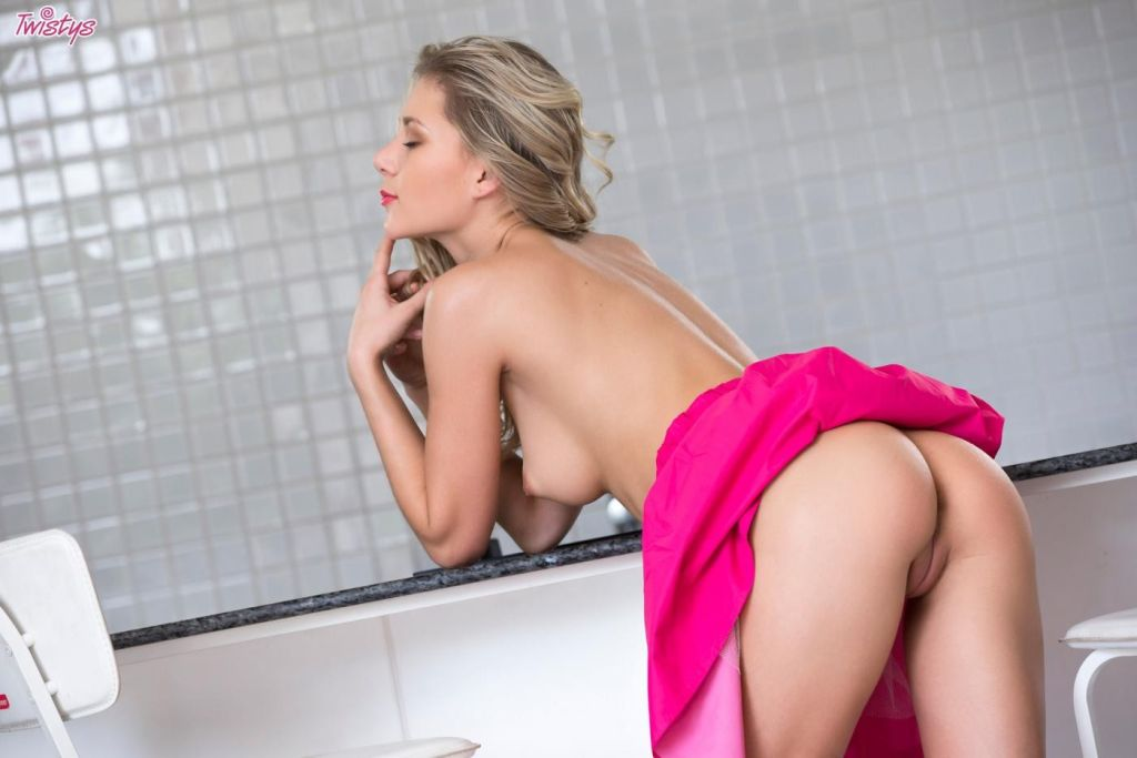 Playful blonde hottie reveals her sexy long legs a