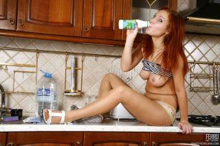Frisky redhead spitting milk onto her barely visib