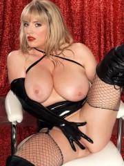 Big boobed Maggie Green in fetish dominatrix outfi