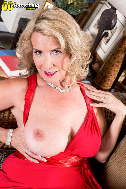 The busty super MILF Laura Layne