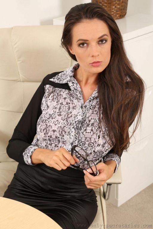 Leggy busty office brunette in stockings