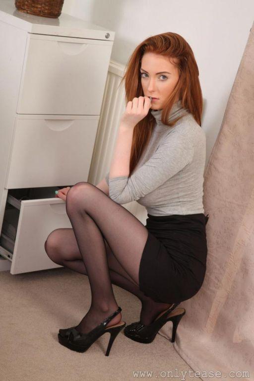 Busty topless secretary in pantyhose