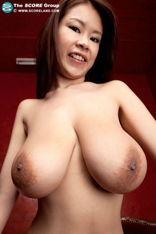 Busty japanese pornstar Rin Kajika rubs her asian