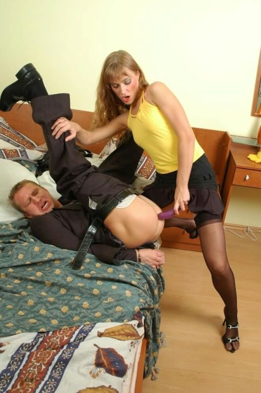 Mistress seducing a guy to strapon sex and fucking