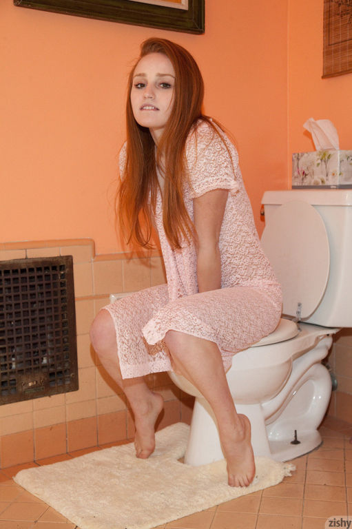 Cute redhead babe Sarah Rupe teasing in her dressi