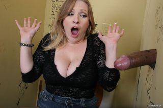 Busty Vicky Vixen sucking a big black at gloryhole