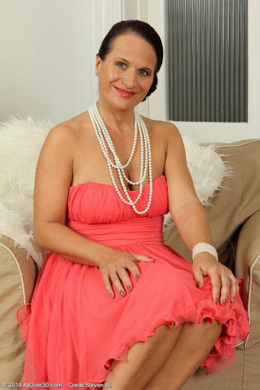 Elegant brunette MILF Thalia slips off her dress t