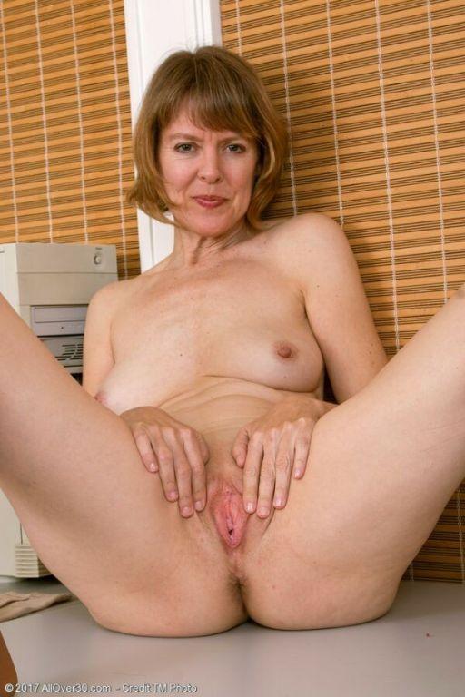 Jamie Foster milf secretary in pantyhose strips at
