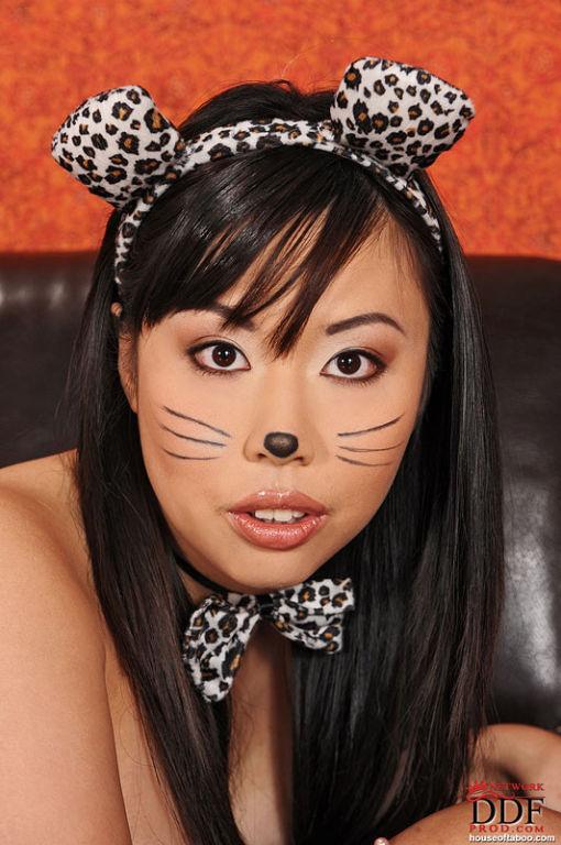 Tattooed Asian Tigerr Benson rubs her big tits and
