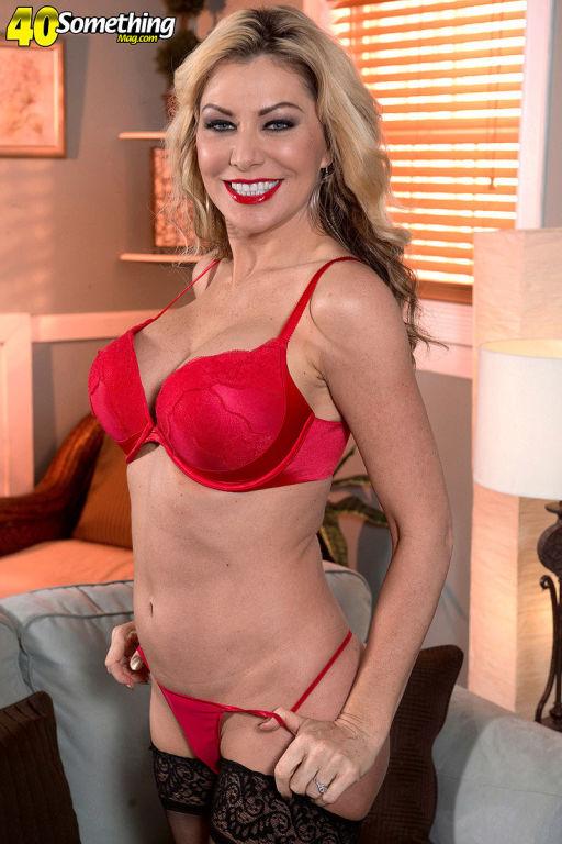 Busty MILF Sasha Strange stripping in red