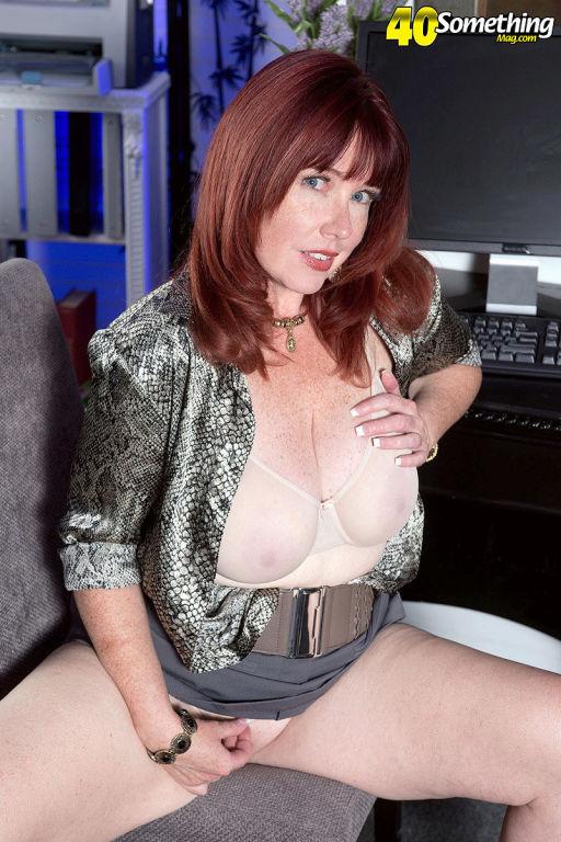 Chubby mom Heather Barron spreading her big tits