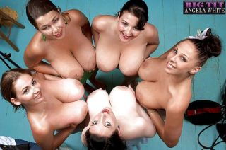 Busty MILF lesbians oil up big boobs on beach