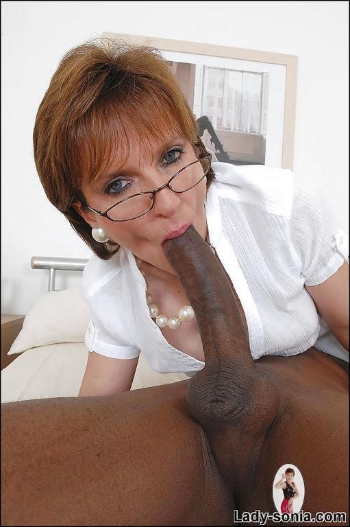 British mature lady sucking a big black cock