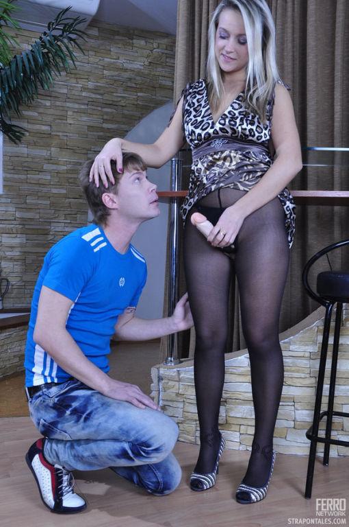 Brazen blonde brandishes her strapon cock ready to
