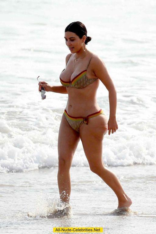 Celebrity Kim Kardashian posing in bikini on beach