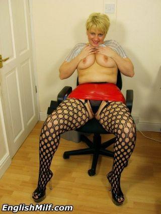 Hot n horny secretary Daniella in tight red rubber