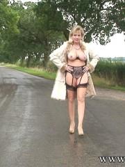British mature flashing outdoors