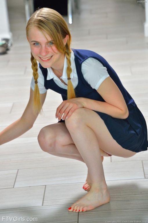 Sweet teenie posing in her schoolgirl uniform