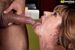 Mature chick enjoys hot facial on her face