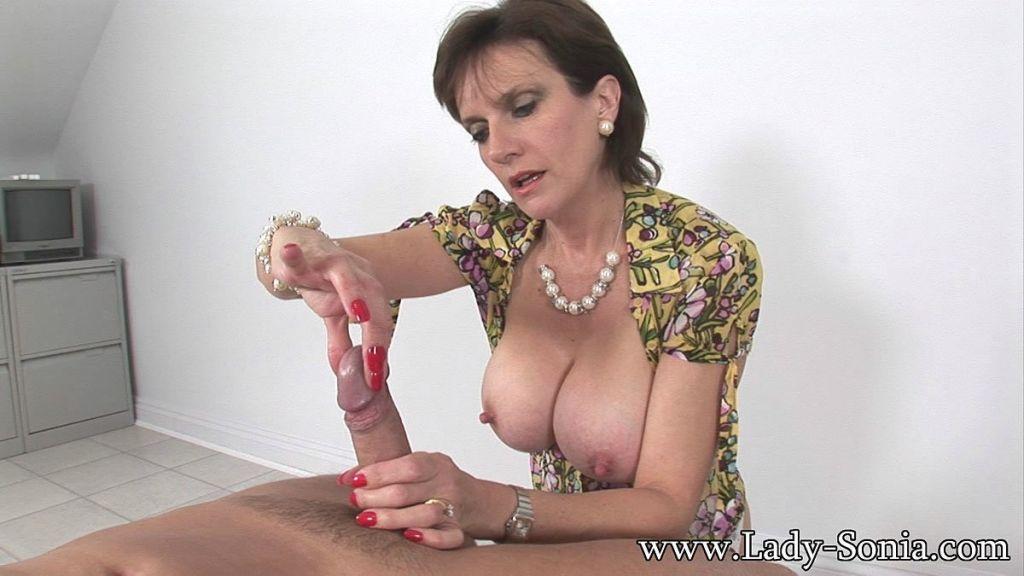 Oiled busty MILF Lady Sonia handjobs a cock
