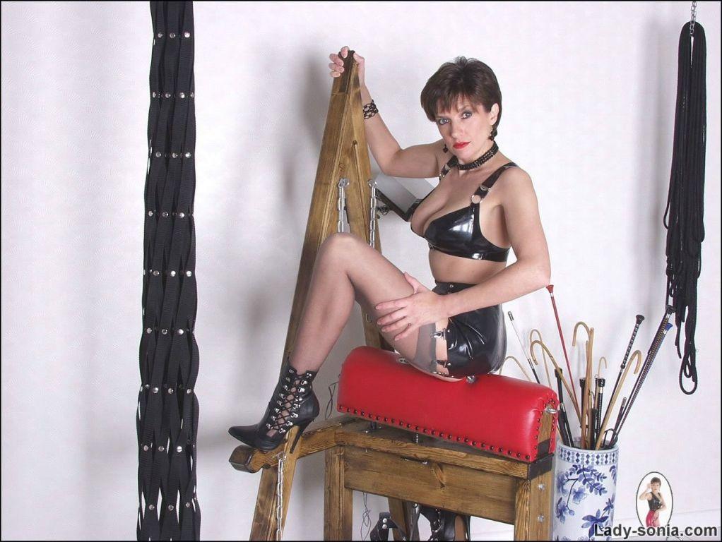 British rubber slut Lady Sonia playing in bdsm gym