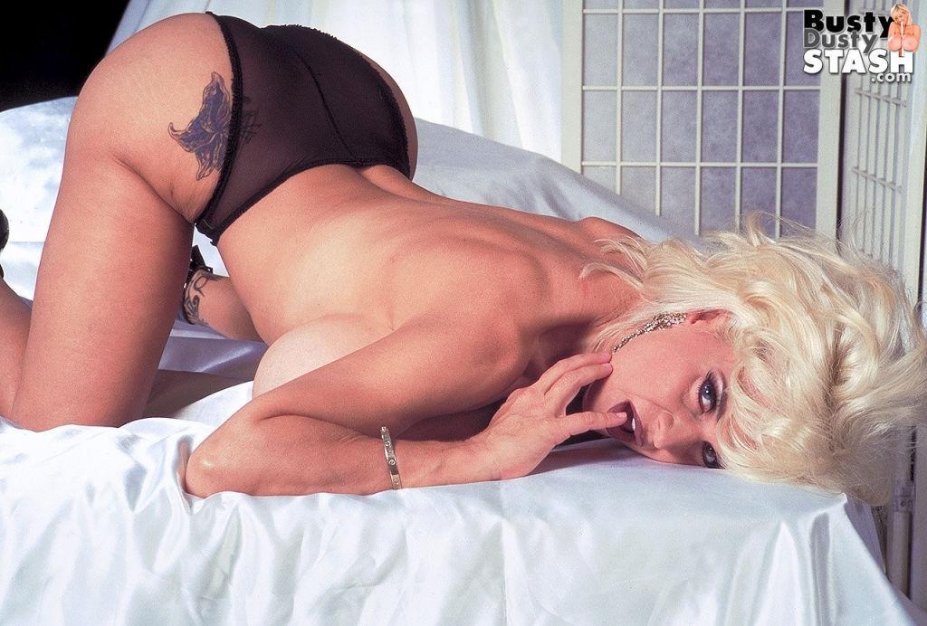 Big titted blonde pornstar Busty Dusty teasing in