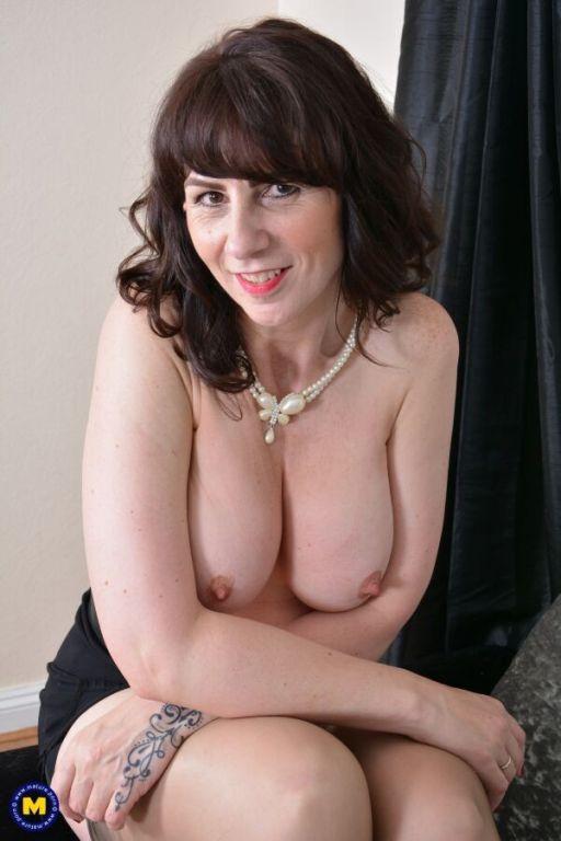 Toni Lace busty milf hottie in tan stockings strip