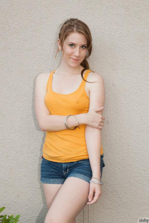 Cute girl Olivia Pelton posing in shorts outdoor