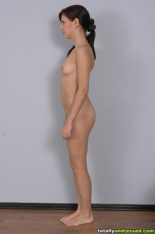 Undressing woman before a fetish job exam