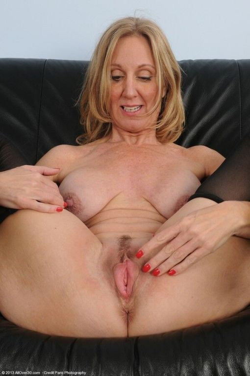 Jenna Covelli busty mature blonde in stockings sho