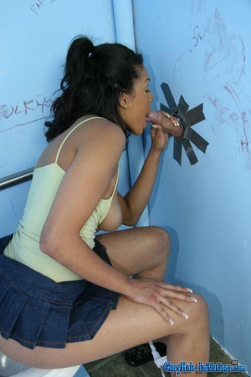 Ebony Desiree Diamond sucking a white at gloryhole