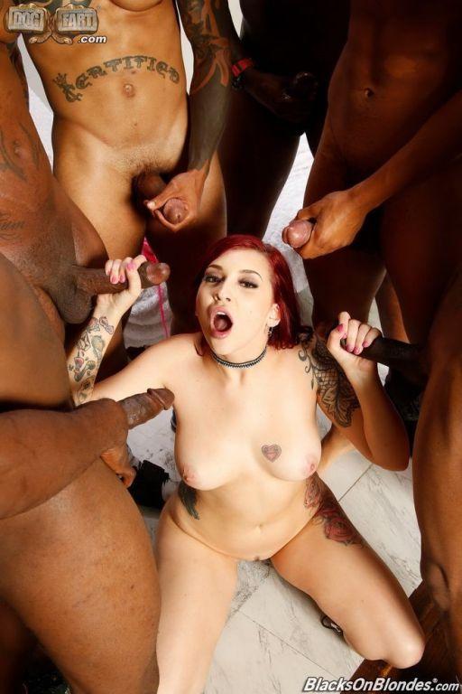 Redhead Amber Ivy in an interracial gang bang fuck