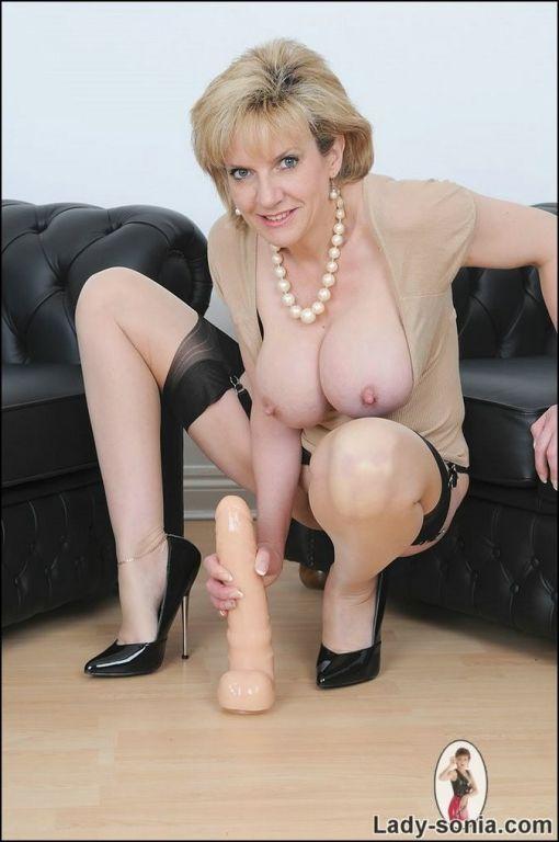 Hot milf Lady Sonia sitting on big sex toy