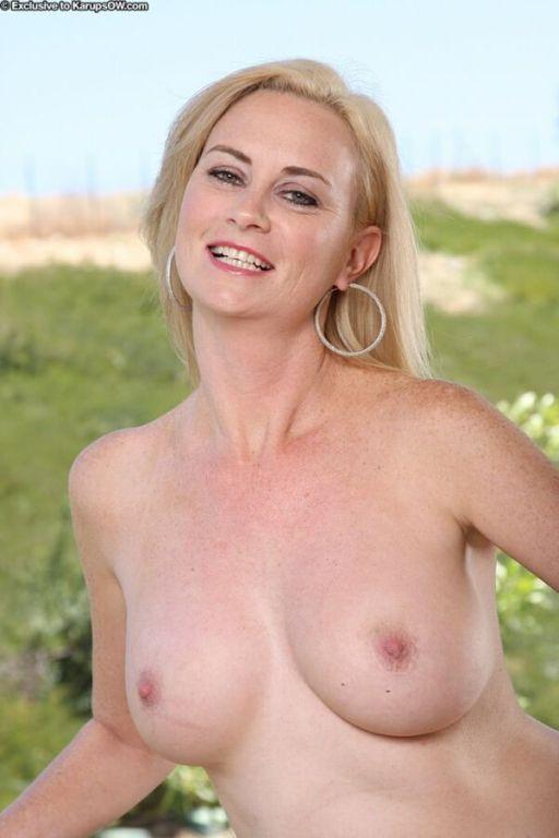 Camryn Cross busty milf blonde in red dress strips