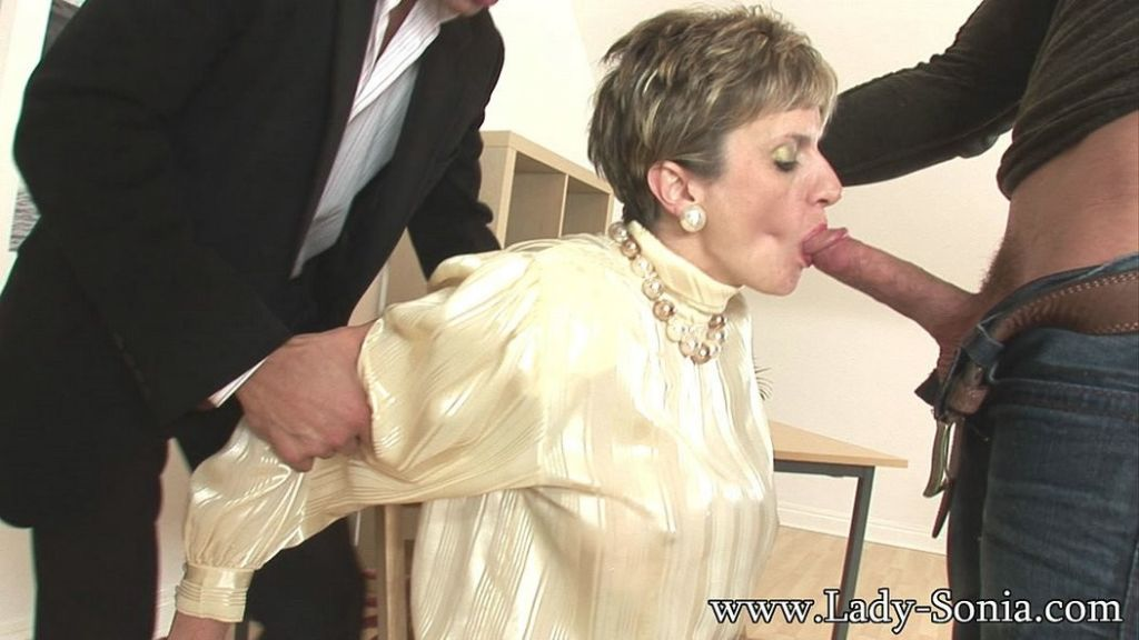 MILF Lady Sonia gagging on hard boner