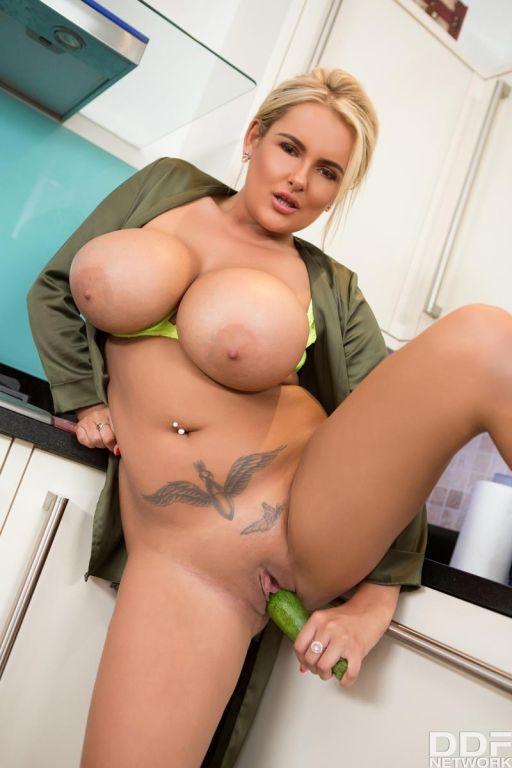 Hot busty blonde fucks a huge cucumber