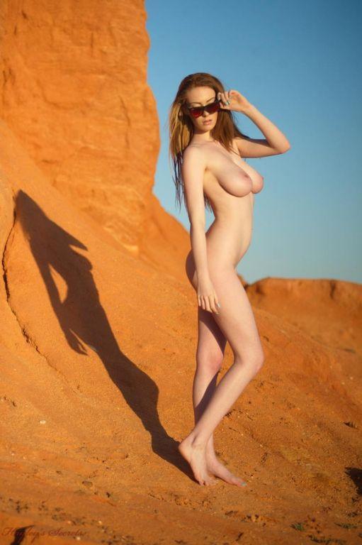 Busty fit bikini babe in the desert