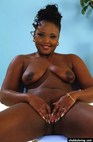 Young ebony plumper Fusha getting naked and spread