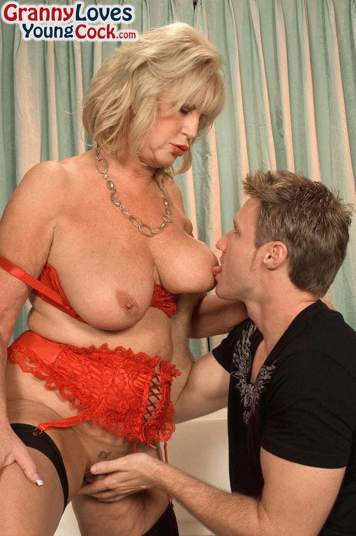 Blonde busty mom Anneke Nordstrum sucking her boy