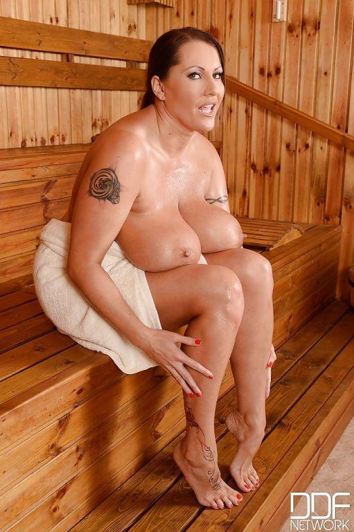 Big tits milf Laura Orsolya masturbating in sauna