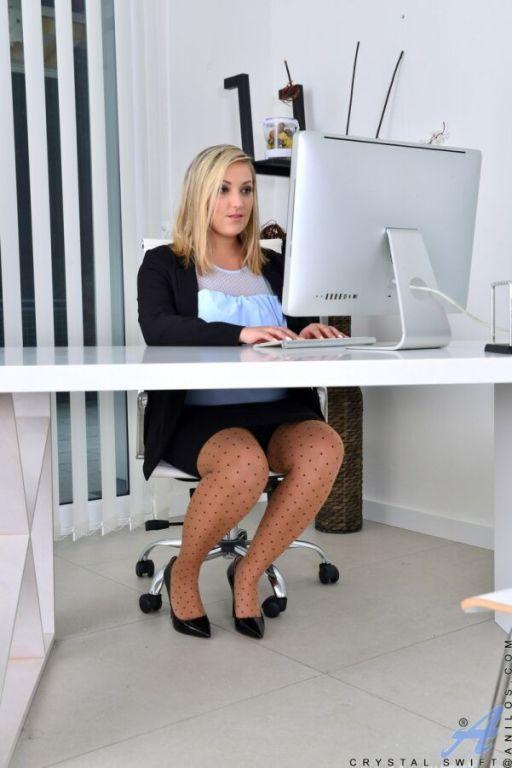 Crystal Swift busty blonde secretary in stockings