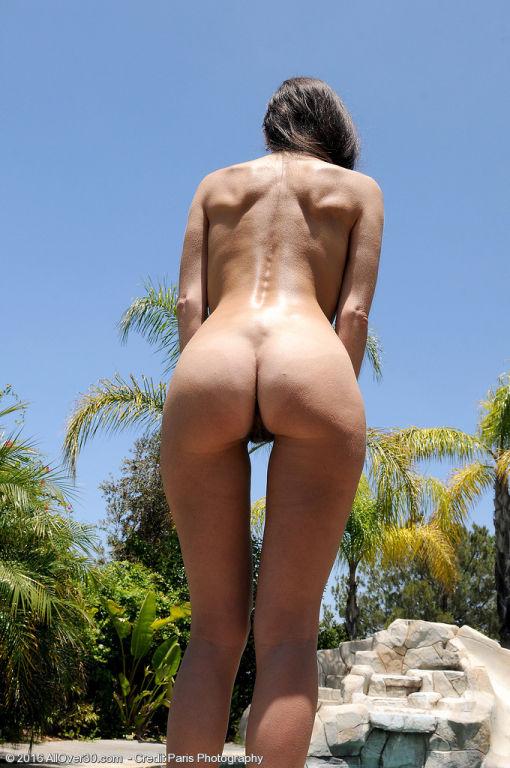 Sexy Bella G Relaxes Nude Outdoors