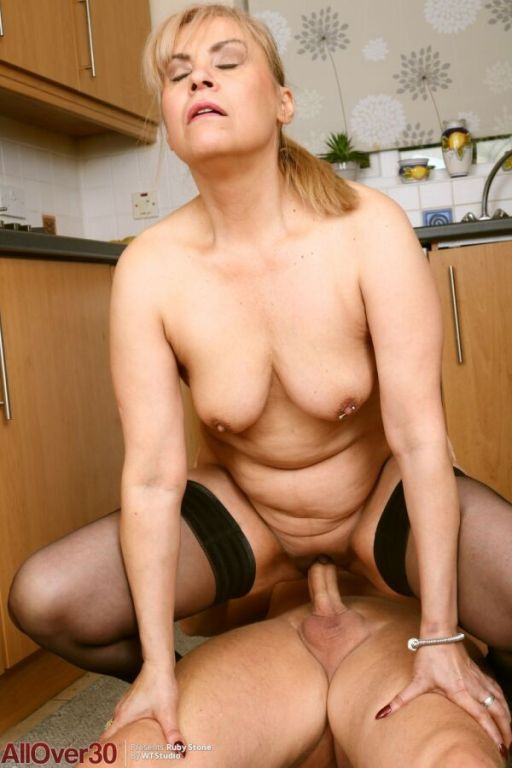 Ruby Stone mature blonde in stockings fucking on k
