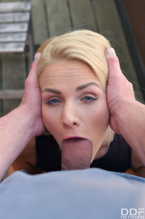 Katy Sky sexy blonde sucks cock on a terrace