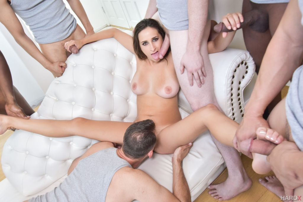 Ashley Adams takes on 10 guys in this intense blow