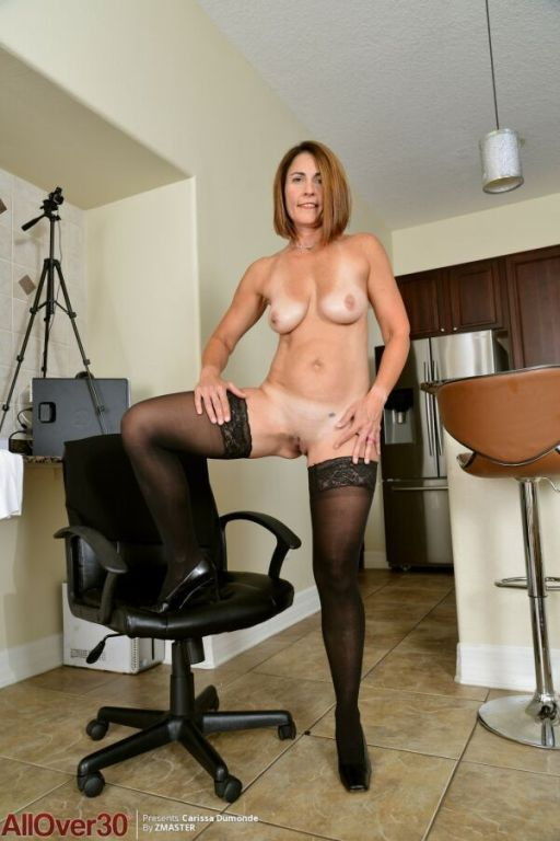Carissa Dumonde in black stockings strips in armch